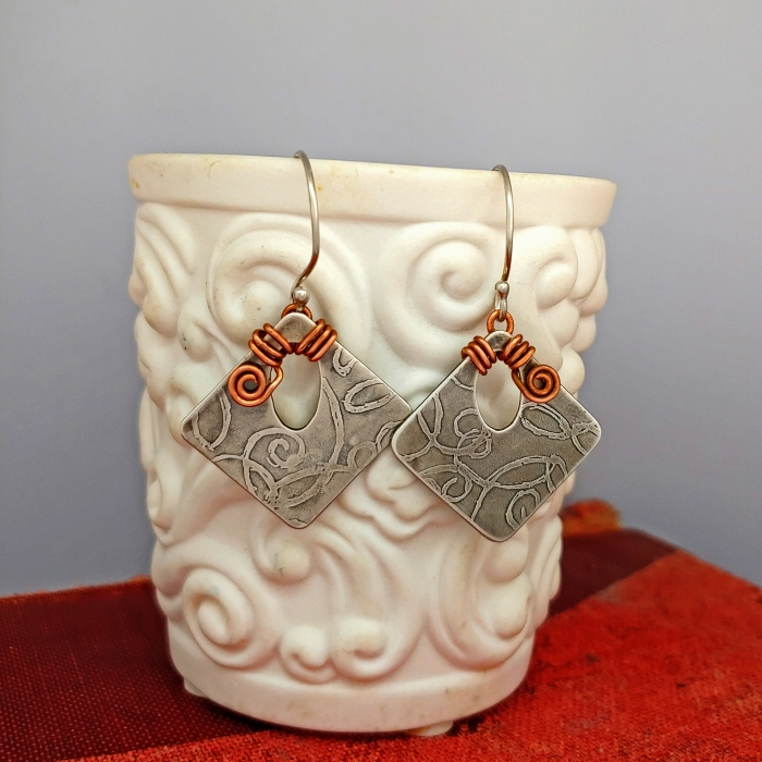 Sterling silver swirl etched diamonds with copper wire wrapping