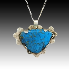 Blue turquoise triangle over fluted silver